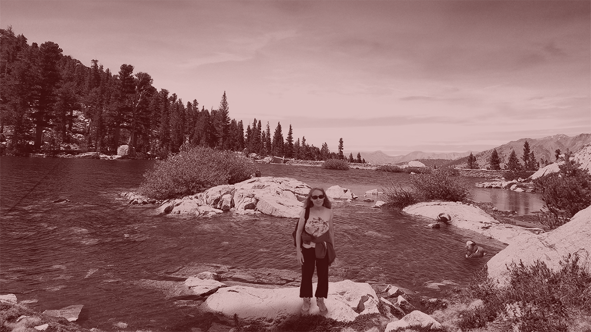 Duotone-like photo of Joy at an alpine lake.